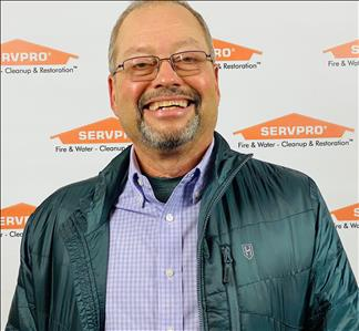 male, glasses, smiling, SERVPRO background